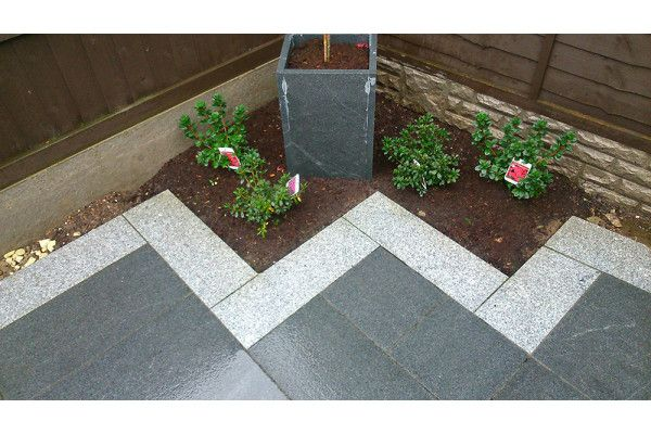 Wet Dark Grey Granite with Light Grey Granite Border