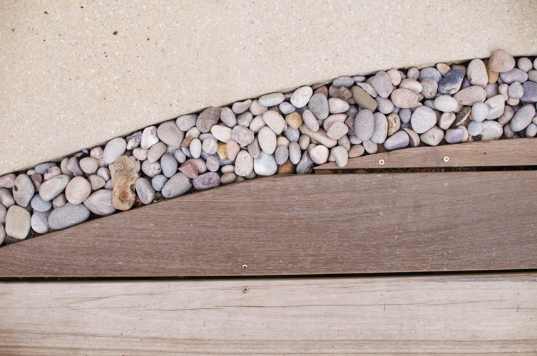 Image of garden gravel in between patio slabs