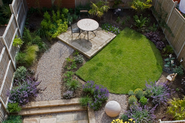 Paul Bains townhouse garden design using decorative aggregates as path up to patio section